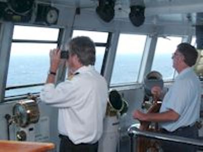 Captain Kevin Fitch helps Scott Peck, Wheelsman, navigate into port.  Photo courtesy of the SS Badger